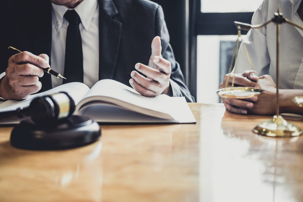 Male lawyer or Counselor working in courtroom have meeting with client are consultation with