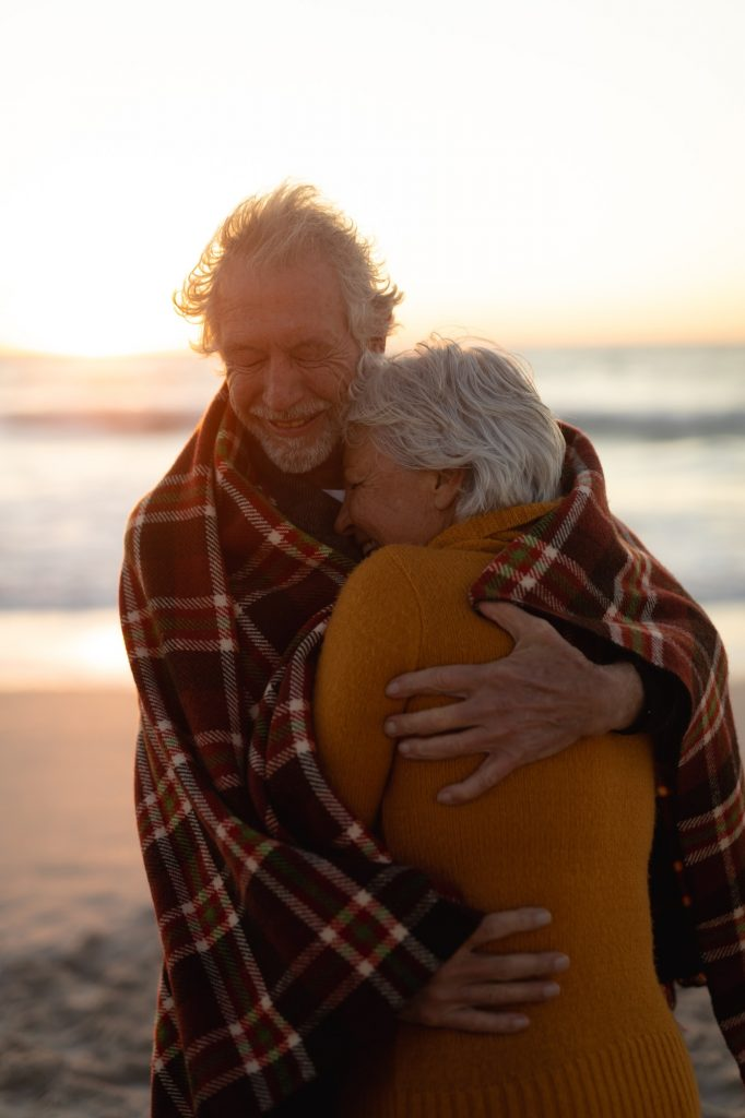 Old couple in love at the beach